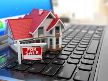 Model house for sale on a laptop keyboard